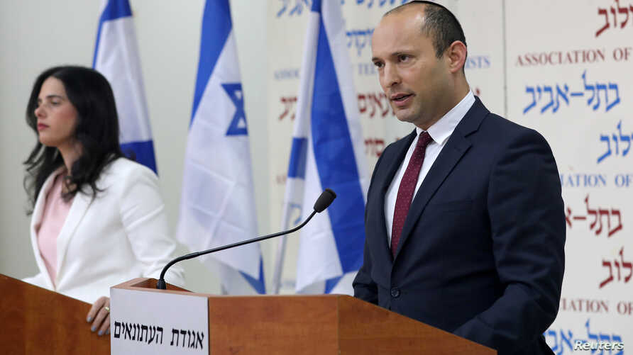 Israeli Education Minister Naftali Bennett, right, and Justice Minister Ayelet Shaked, from the Jewish Home party, deliver statements in Tel Aviv, Dec. 29, 2018.