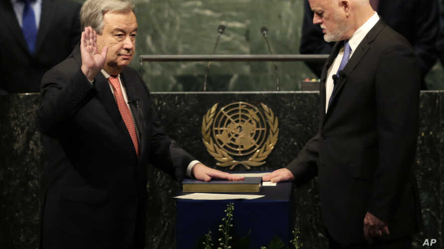 The United Nations Secretary-General designate Antonio Guterres, left, is sworn in by Peter Thomson, president of the UN General Assembly, at U.N. headquarters, Dec. 12, 2016.