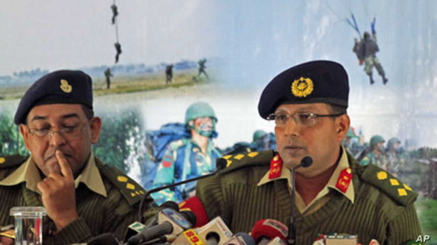Brigadier General Muhammad Masud Razzaq (R) talks about what he said was a coup attempt by retired and serving officers late last month, which intelligence sources said was driven by a campaign to introduce Sharia law throughout the majority Muslim c