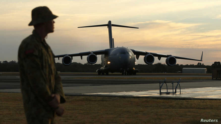An Australian Air Force C-17 taxis at the RAAF Base Pearce near Perth, March 28, 2014. The C-17 delivered an Australian Navy SeaHawk helicopter which will be used in the search for Malaysian Airlines flight MH370 in the southern Indian Ocean.