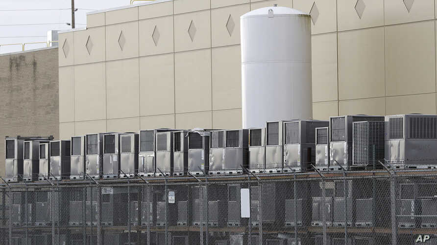 Air conditioning units are stacked outside the Carrier Corp. plant, in Indianapolis, Nov. 30, 2016.