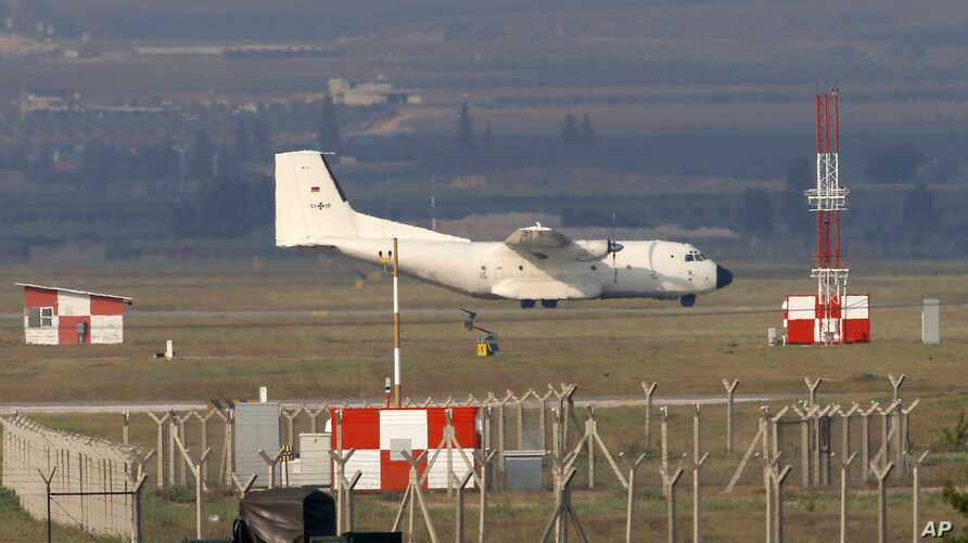 FILE - A German Air Force cargo plane maneuvers on the runway after landing at the Incirlik Air Base, near the city of Khona, southern Turkey, July 29, 2015.