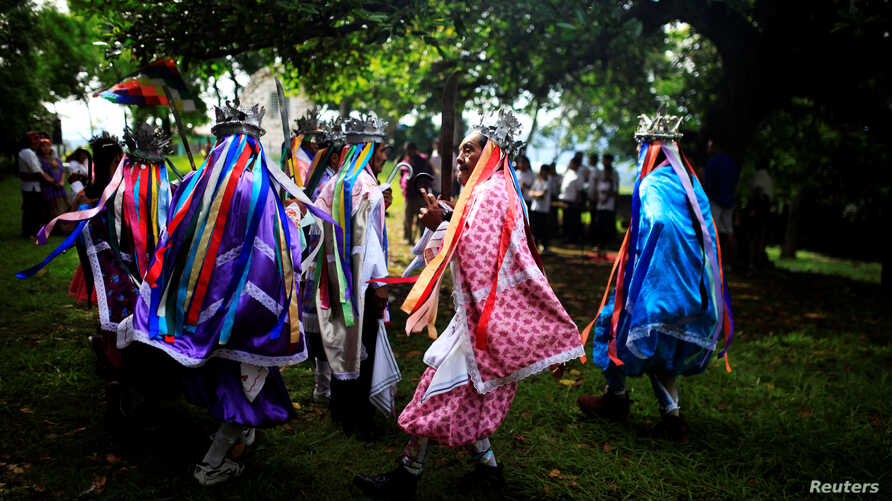 Traditional dancers participate in a traditional ceremony to commemorate the International Day of the World's Indigenous People in Izalco, El Salvador, August 9, 2016.