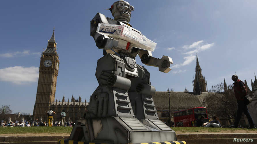 FILE - A robot is pictured in front of the Houses of Parliament and Westminster Abbey as part of the Campaign to Stop Killer Robots in London, April 23, 2013.