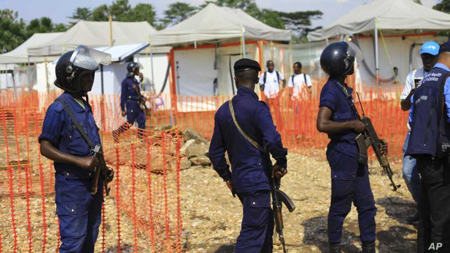 Police officers stand guards at a newly established Ebola response center in Beni, Democratic Republic of Congo, Aug. 10, 2018.