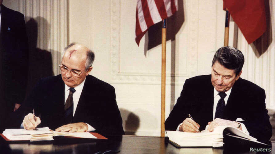 FILE - U.S. President Ronald Reagan and Soviet President Mikhail Gorbachev sign the Intermediate-range Nuclear Forces Treaty at the White House, Dec. 8 1987.