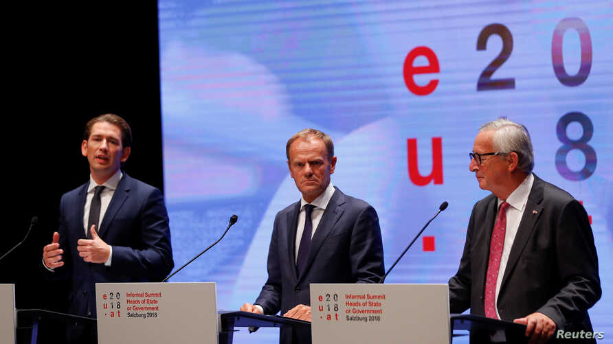 European Council President Donald Tusk (from left), European Commission President Jean-Claude Juncker and Austrian Chancellor Sebastian Kurz hold a news conference after the informal meeting of European Union leaders in Salzburg, Austria, Sept. 20, 2