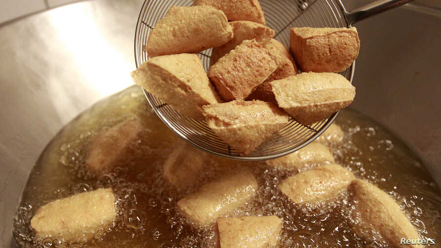FILE - Stinky tofu is seen fried at the Jiaziyuan Restaurant in New Taipei city.