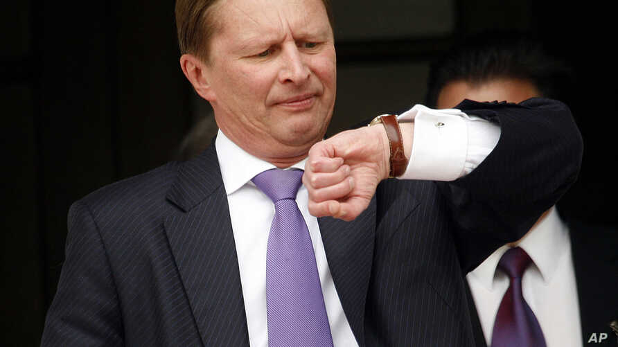 Russia's First Deputy Prime Minister Sergei Ivanov looks at his watch after leaving the official residence of Greek Prime Minister Costas Karamanlis, on Monday, May 7, 2007. Ivanov, seen here wearing an gold tie clip shaped like an AK-47 automatic ri