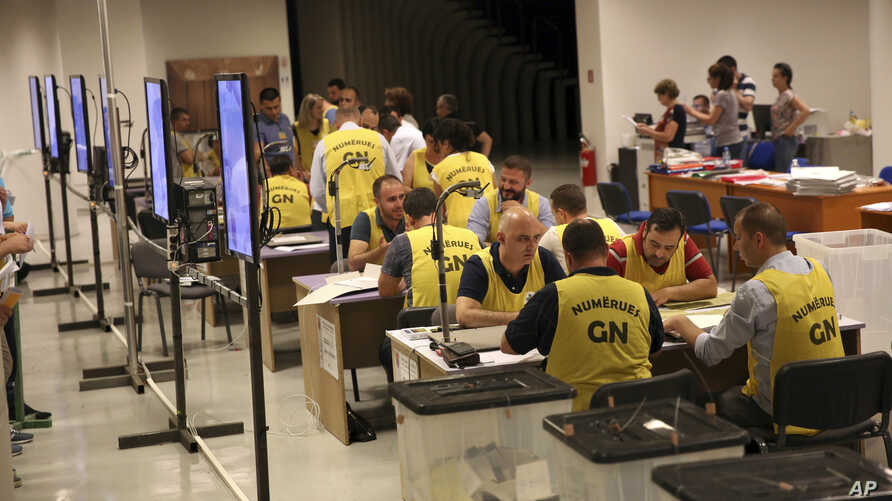 Election staff count ballots in Tirana, Albania, June 26, 2017.
