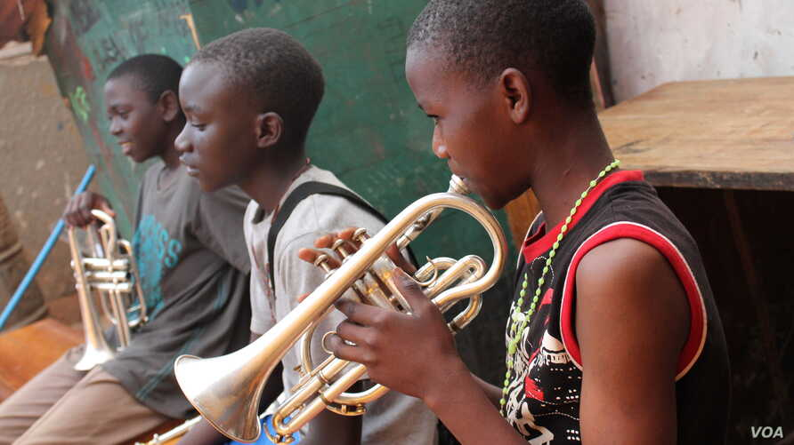 The children living at M-lisada practice their instruments every day, Kampala, Uganda, Oct. 11, 2013. (Hilary Heuler for VOA)
