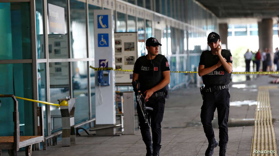Police officers patrol at Turkey's largest airport, Istanbul Ataturk, following yesterday's blast, June 29, 2016.
