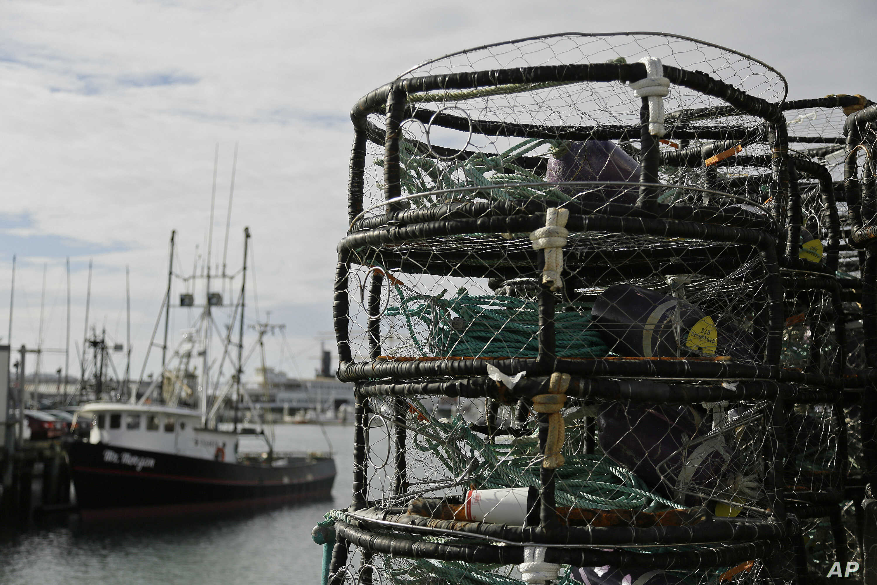 File - In this Nov. 5, 2015 file photo, crab pots are stacked along a pier at Fisherman's Wharf in San Francisco.