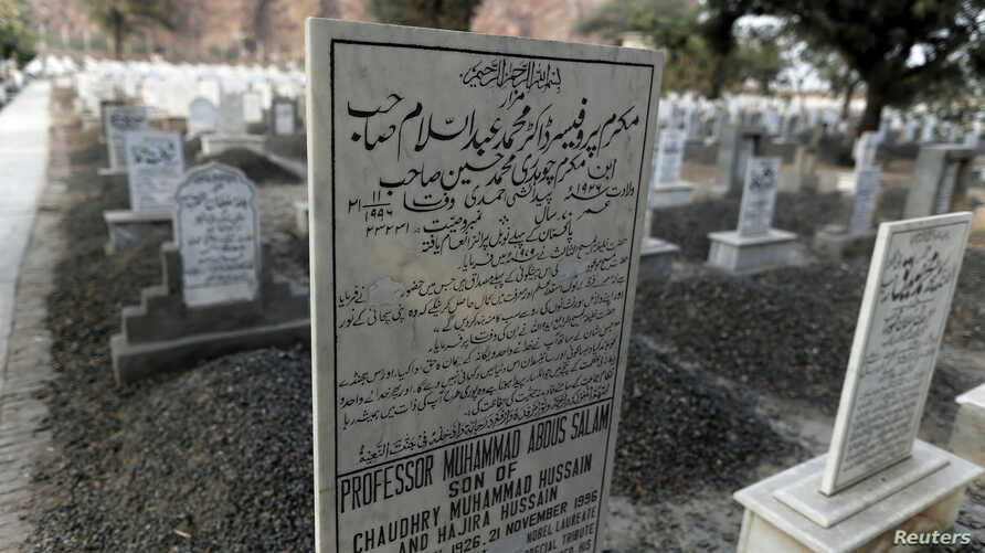 "The word ""Muslim"" has been painted over by vigilantes, on the tombstone of Pakistani scientist Abdus Salam, a member of the Ahmadi community and Pakistan's only Nobel laureate, in the Ahmadi graveyard in the town of Rabwa, Dec. 9, 2013. A recent assa"