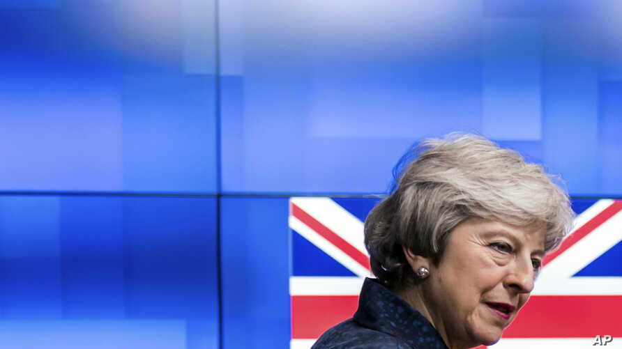Britain's Prime Minister Theresa May arrives to meet European Council President Donald Tusk at the European Council headquarters in Brussels, Feb. 7, 2019.