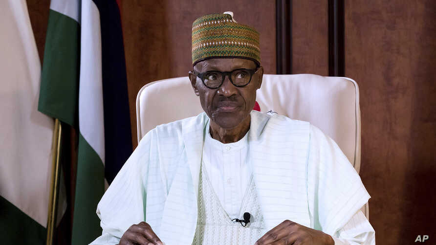 In this photo released by the Nigeria State House, Nigeria's President Muhammadu Buhari looks on during a broadcast to the Nation at the Presidential palace in Abuja, Nigeria, Aug. 21, 2017.