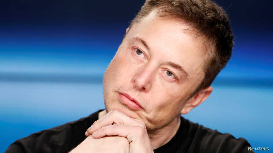 FILE - Elon Musk listens at a press conference following the first launch of a SpaceX Falcon Heavy rocket at the Kennedy Space Center in Cape Canaveral, Florida, U.S., Feb. 6, 2018.