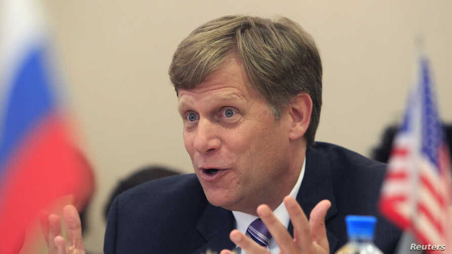 U.S. Ambassador to Russia Michael McFaul gestures during his meeting with deputies of the United Russia party at Russia's State Duma, lower house of parliament, in Moscow, May 25, 2012.