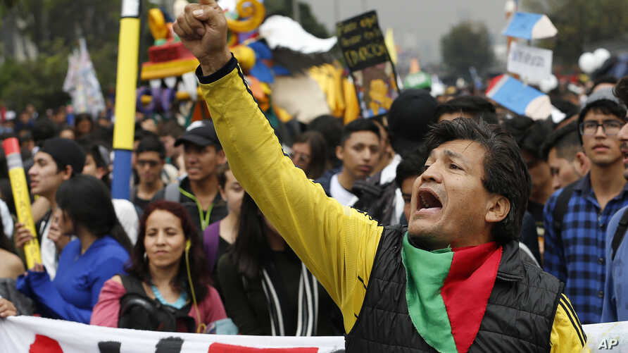 A man yells during a protest asking for a hike in the budget for public higher education, in Bogota, Colombia, Nov. 15, 2018.
