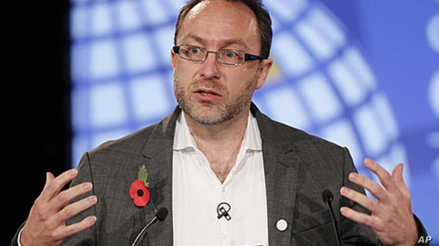 Wikipedia co-founder Jimmy Wales gestures during the opening session at the London Cyberspace Conference, November 1, 2011.