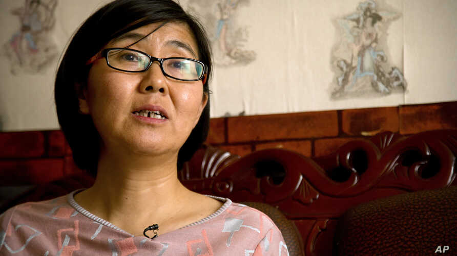 FILE - In this April 18, 2015 photo, Wang Yu, a lawyer for Chinese activist Li Tingting, speaks during an interview in Beijing.