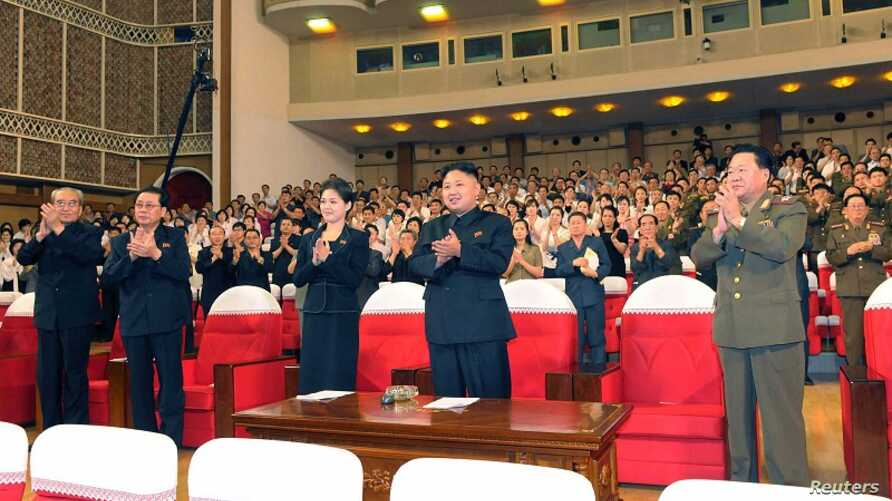 North Korean leader Kim Jong Un (Center) applauds during a demonstration performance by the newly formed Moranbong band in Pyongyang, July 9, 2012
