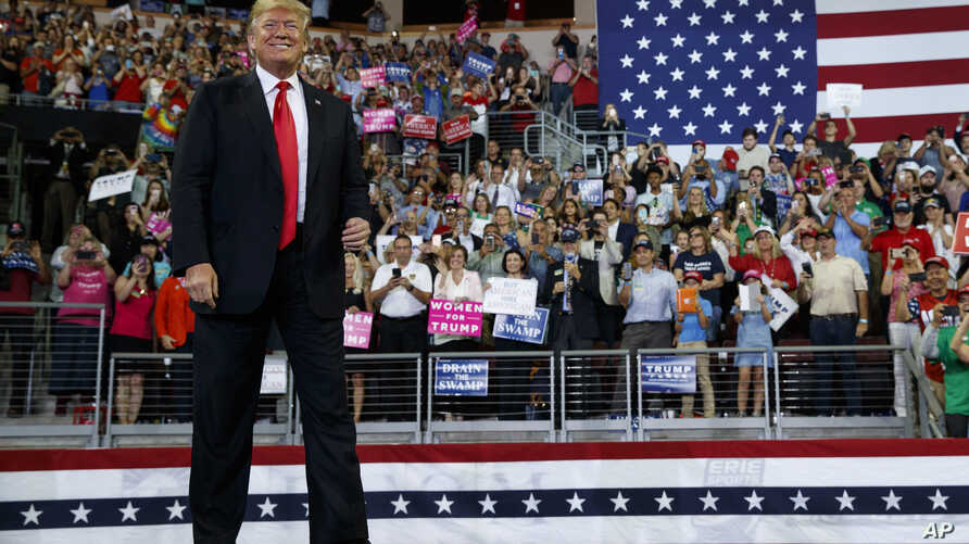 President Donald Trump arrives to speak at a campaign rally at Erie Insurance Arena, Oct. 10, 2018, in Erie, Pa.
