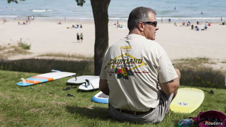 A spectator watches the action at the country's largest freshw.ater surf event taking place Labor Day weekend in Sheboygan, Wisconsin, September 1, 2012.