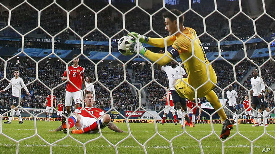 France's goalkeeper Hugo Lloris saves his goal during the international friendly soccer match between Russia and France at the Saint Petersburg stadium in St.Petersburg, Russia, March 27, 2018.