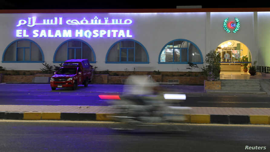 A motorcyclist rides past a police vehicle parked at the El Salam Hospital, after a fatal knife attack in Hurghada, Egypt, July 15, 2017.