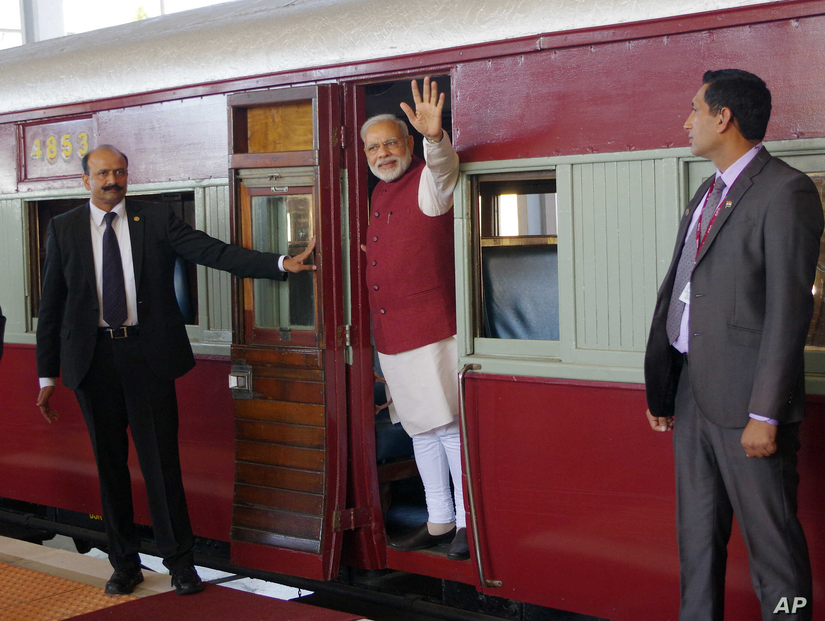 Indian Prime Minister Narendra Modi waves from a train carriage at Pentrich Railway station in Pietermaritzburg, South Africa, July 9, 2016. Modi took the same trip that Mahatma Gandhi took in 1893 when he was thrown off the train because of his race