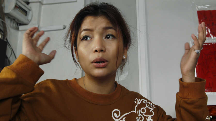 Cambodian actress Sasa, 28, whose real name is Ek Socheata, speaks with The Associated Press at her clothing shop in Phnom Penh, Cambodia, July 16, 2015.