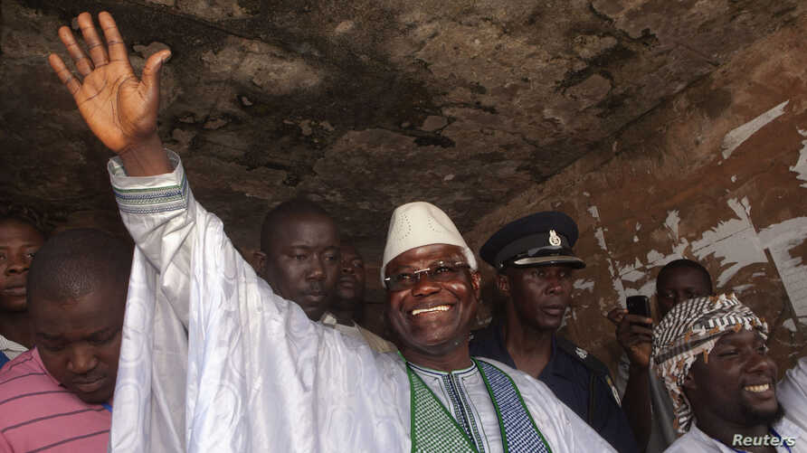 Sierra Leone's incumbent President Ernest Bai Koroma waves to supporters after voting in the capital Freetown, November 17, 2012.
