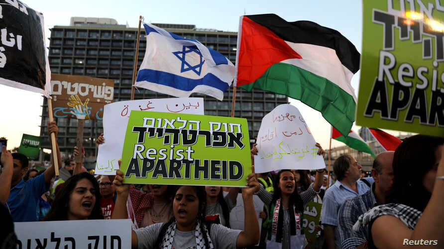 FILE - Israeli Arabs and their supporters take part in a rally to protest against Jewish nation-state law in Rabin square in Tel Aviv, Israel,  Aug. 11, 2018.