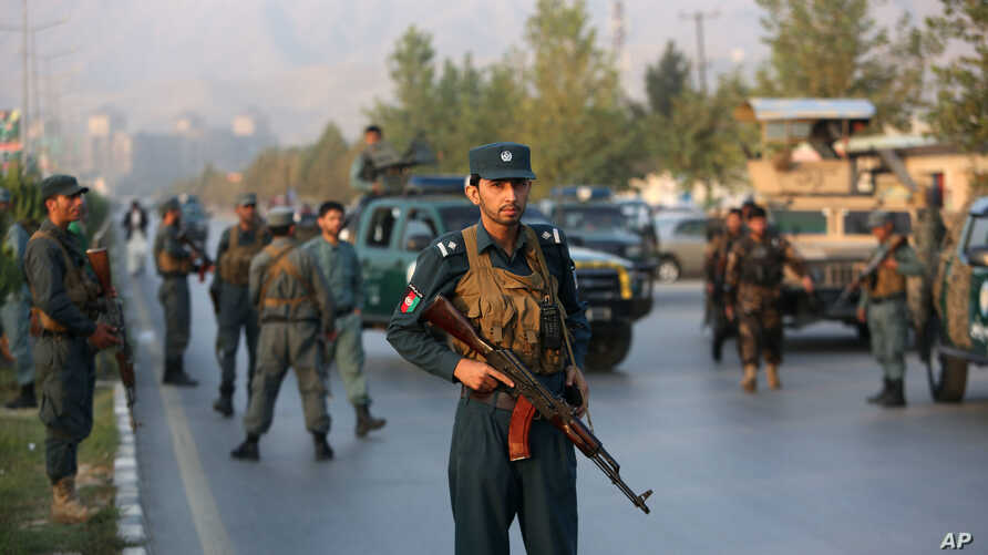 Afghan security forces stand guard after an attack on the American University of Afghanistan in Kabul, Afghanistan, Aug. 25, 2016.