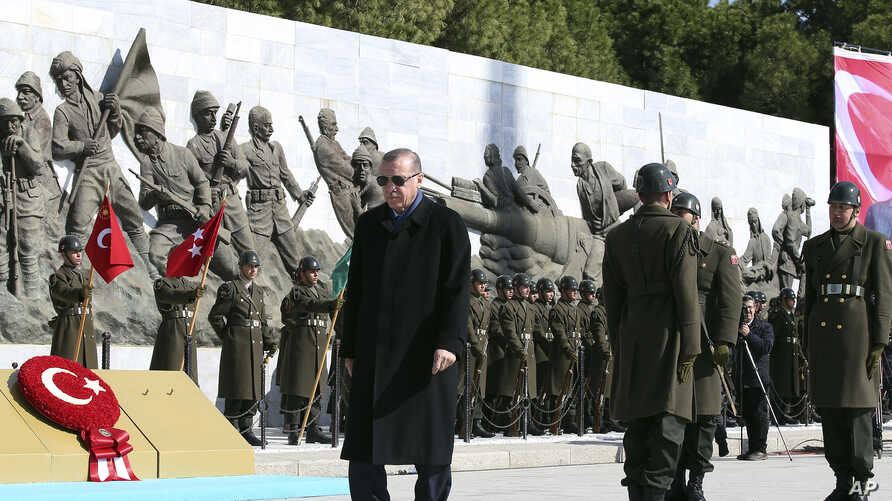 Turkey's President Recep Tayyip Erdogan walks during a ceremony marking the 102nd anniversary of the country's historic Canakkale battle, in Gallipoli peninsula, March 18, 2017.