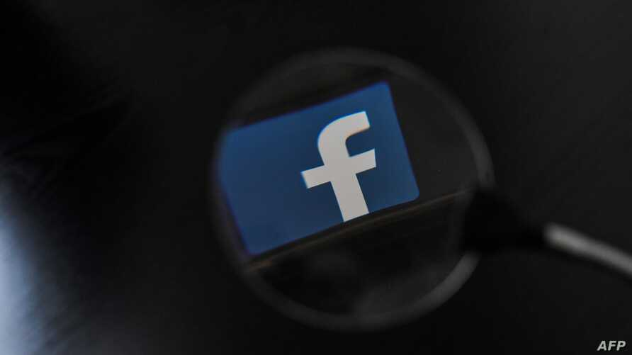 Facebook, whose logo is seen on a smartphone in this file photo, said Jan. 31, 2019, it took down hundreds of accounts from Iran that were part of a vast manipulation campaign operating in more than 20 countries.