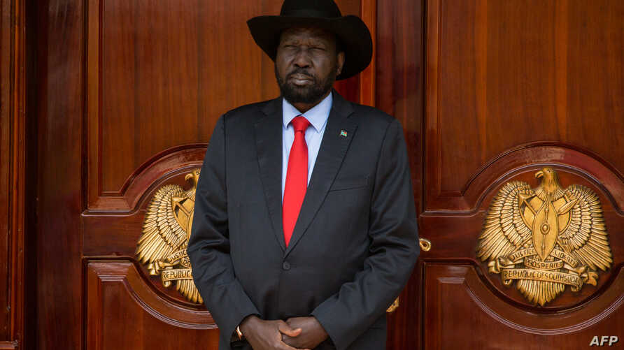 South Sudan's President Salva Kiir waits for the arrival of Eritrea's president Isaias Afwerki and Ethiopia prime minister Abiy Ahmed at the Presidential Palace in Juba on March 4, 2019.