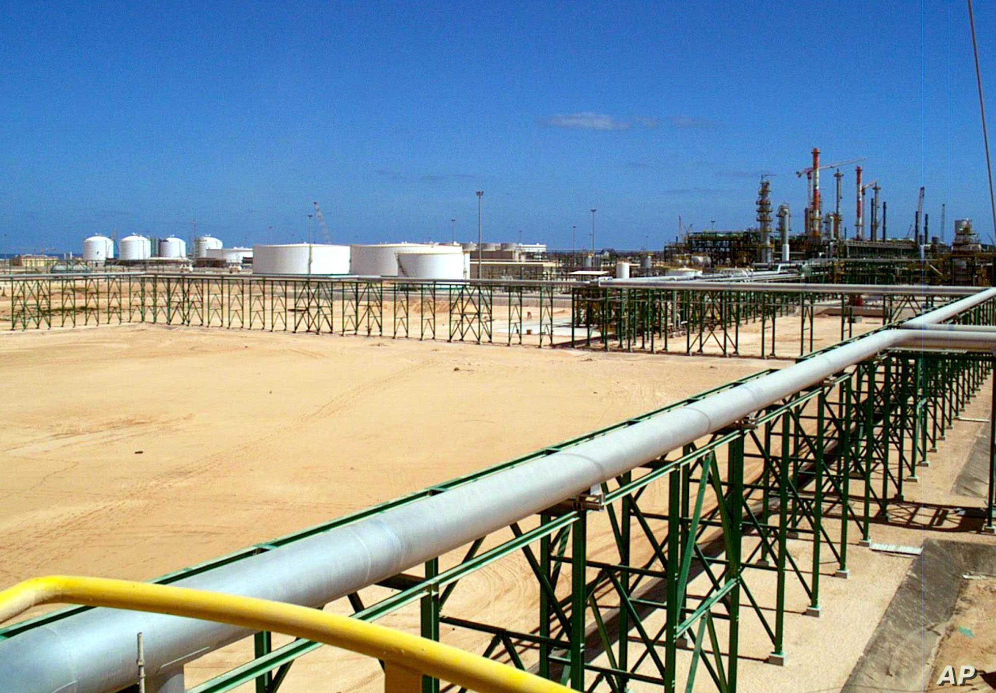 FILE - Eni [Italian oil and gas company] gas compression plant is seen on the shore of Mellitah, Libya.