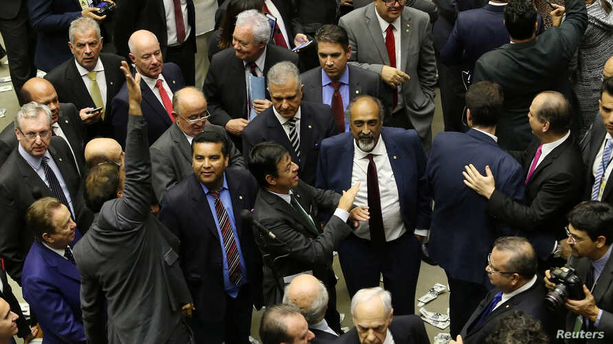 Deputies of the lower chamber of Brazil's Congress celebrate after they voted to reject a corruption charge against Brazilian President Michel Temer in Brasilia, Brazil, Aug. 2, 2017.