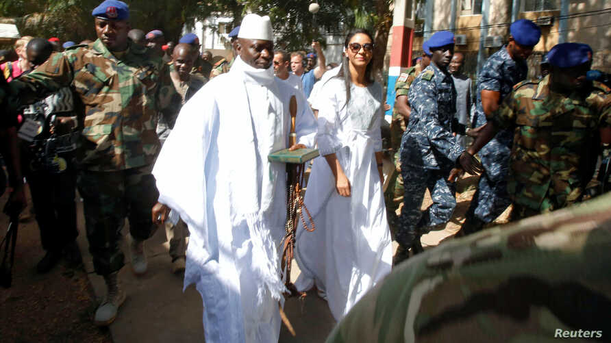 Gambian President Yahya Jammeh arrives at a polling station with his wife Zineb during the presidential election in Banjul, Gambia, Dec. 1, 2016.