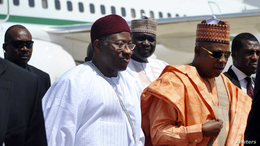 Nigeria's President Goodluck Jonathan (C) on visit to Borno state March 7, 2013