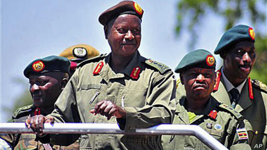 Uganda's President Yoweri Museveni inspects an guard of honor at Soroti, Uganda, during celebrations to mark 30 years of The Uganda Peoples Defence Force, previously the National Resistance Army, February 6, 2011