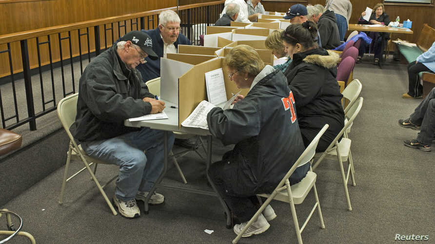 Voters cast their ballots for Tuesday's general election at the Ocean County Administration Building as residents continue to clean up after Hurricane Sandy in Toms River, New Jersey, November 4, 2012.