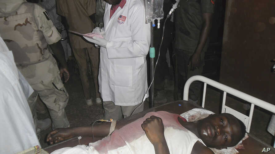 A student wounded during a suicide bomb attack at the College of Administrative and Business Studies receives treatment at a hospital in Potiskum, Nigeria, May 8, 2015.