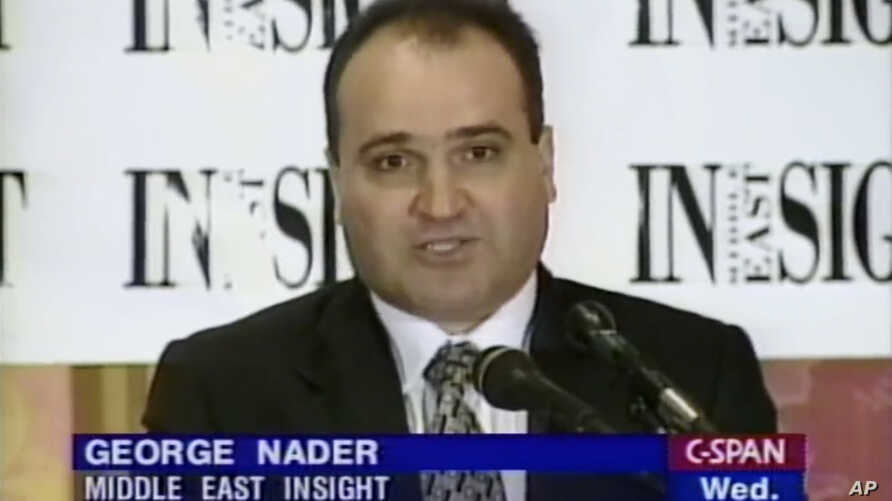 This 1998 frame from video provided by C-SPAN shows president and editor of Middle East Insight George Nader.