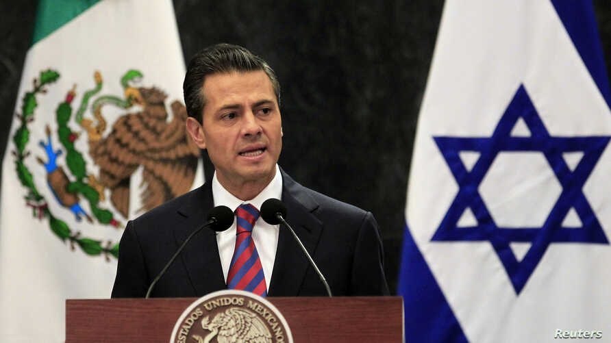 Mexico's President Enrique Pena Nieto gives a speech next to Israel's President Shimon Peres (not pictured) during a news conference after an official welcoming ceremony for Peres at Los Pinos presidential residence in Mexico City, Nov. 27, 2013.