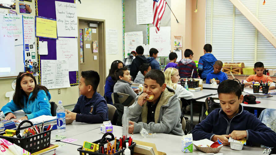 FILE - Students are served breakfast at the Stanley Mosk Elementary School in Los Angeles, April 8, 2015.