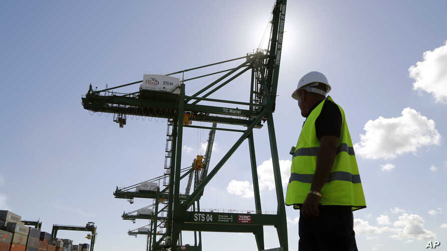 Worker at the container terminal at the port in the Bay of Mariel, Cuba, July 13, 2015.