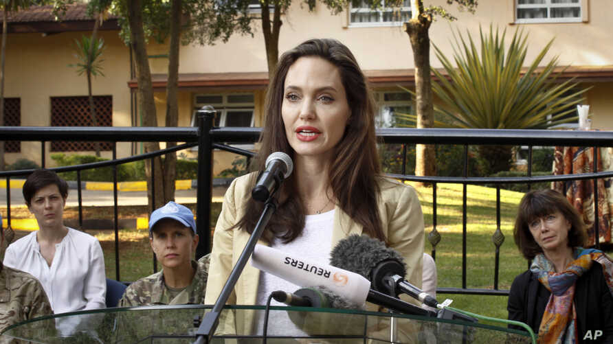 FILE - Actor-director Angelina Jolie speaks to reporters after meeting with the British Peace Support Team for East Africa, at the International Peace Support Training Center in Nairobi, Kenya, June 20, 2017. The activist spoke out against sexual vio